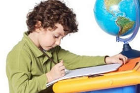 Rules Of Parenting - # - Young Boy At Desk Writing